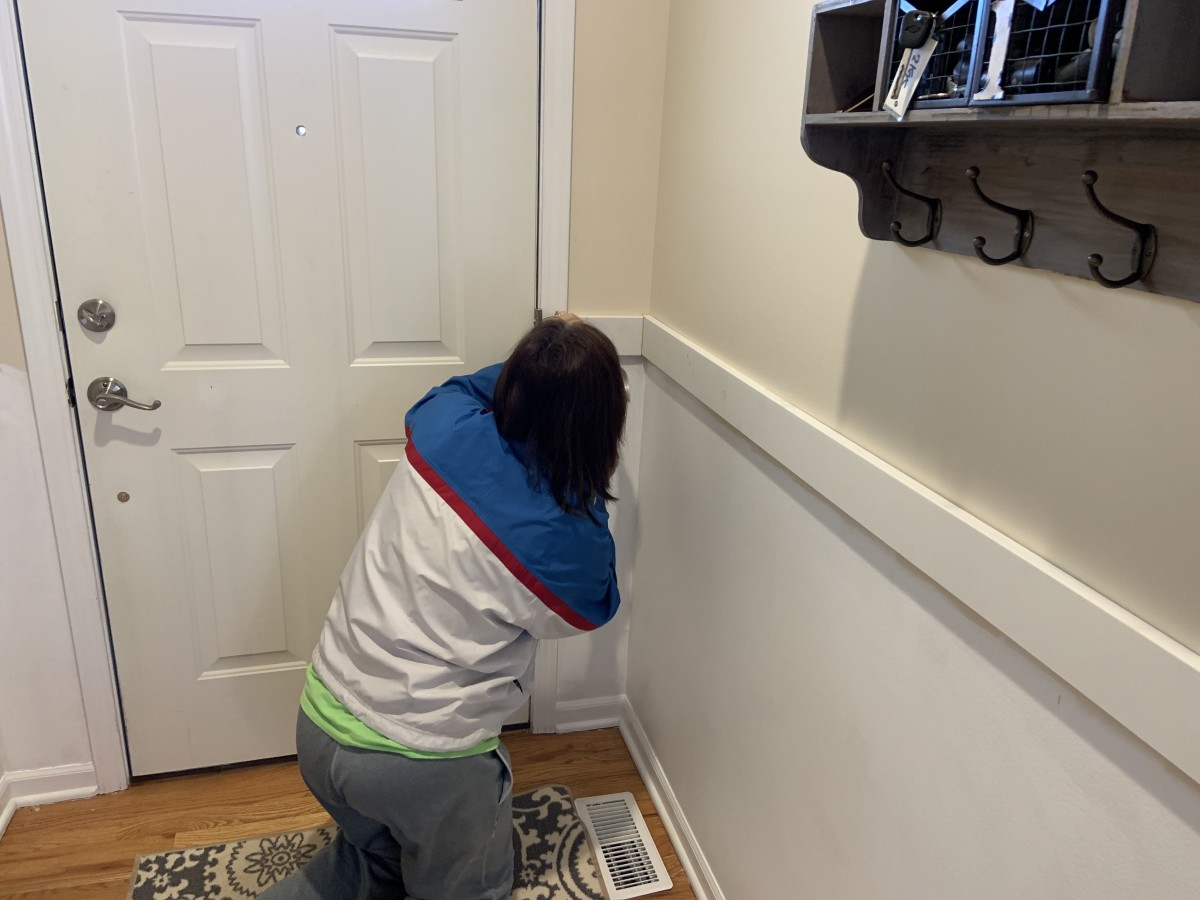 """Installing the horizontal top board. We nailed the horizontal boards (1"""" x 4"""") to the wall studs to make sure they were secure."""