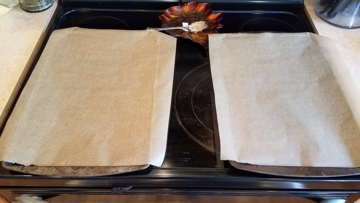 Line two cookie sheets with parchment paper.