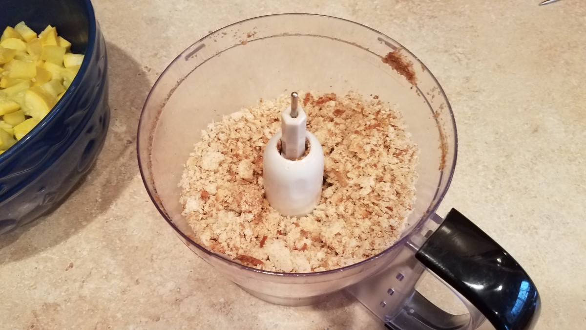 On the side, mix your bread in a food processor or blender to make breadcrumbs.