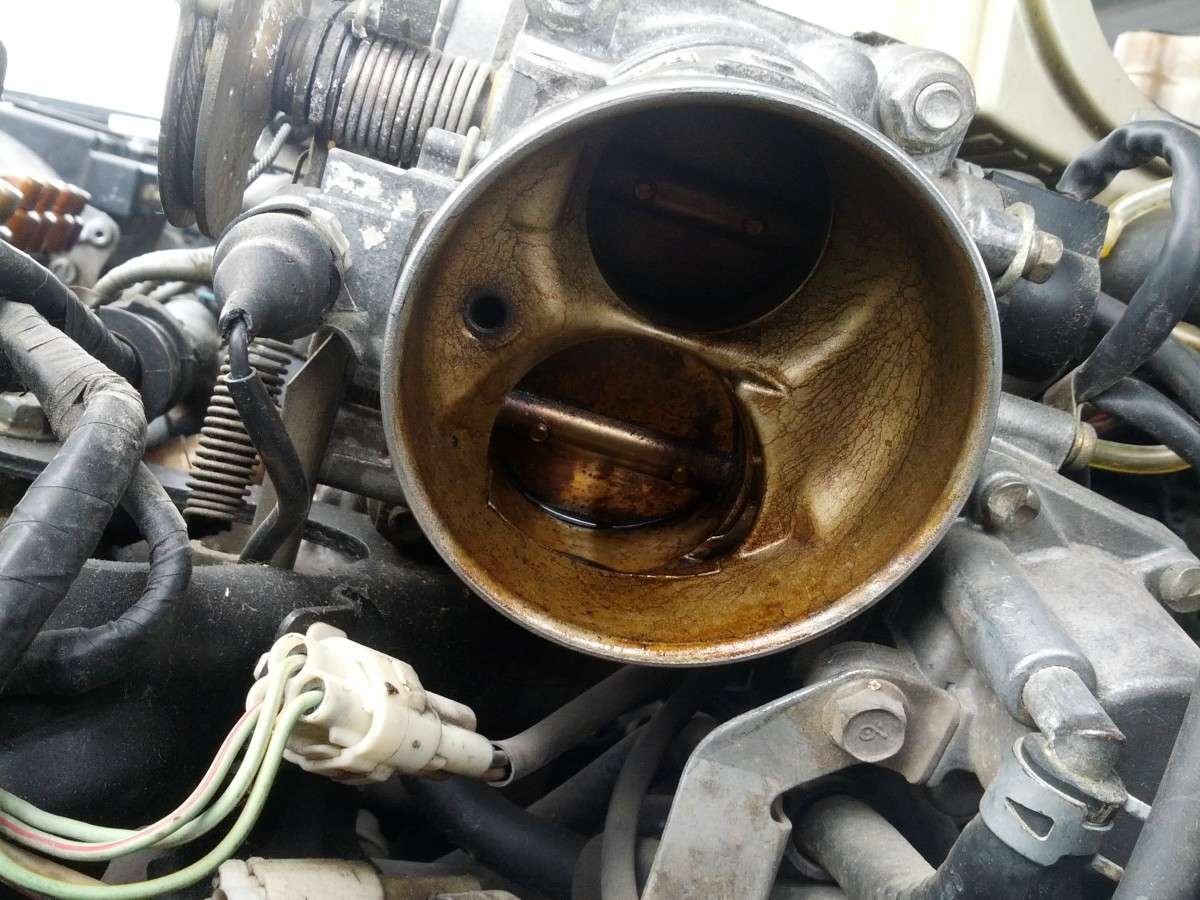 Clean the throttle body and idle air control valve passages, if necessary.