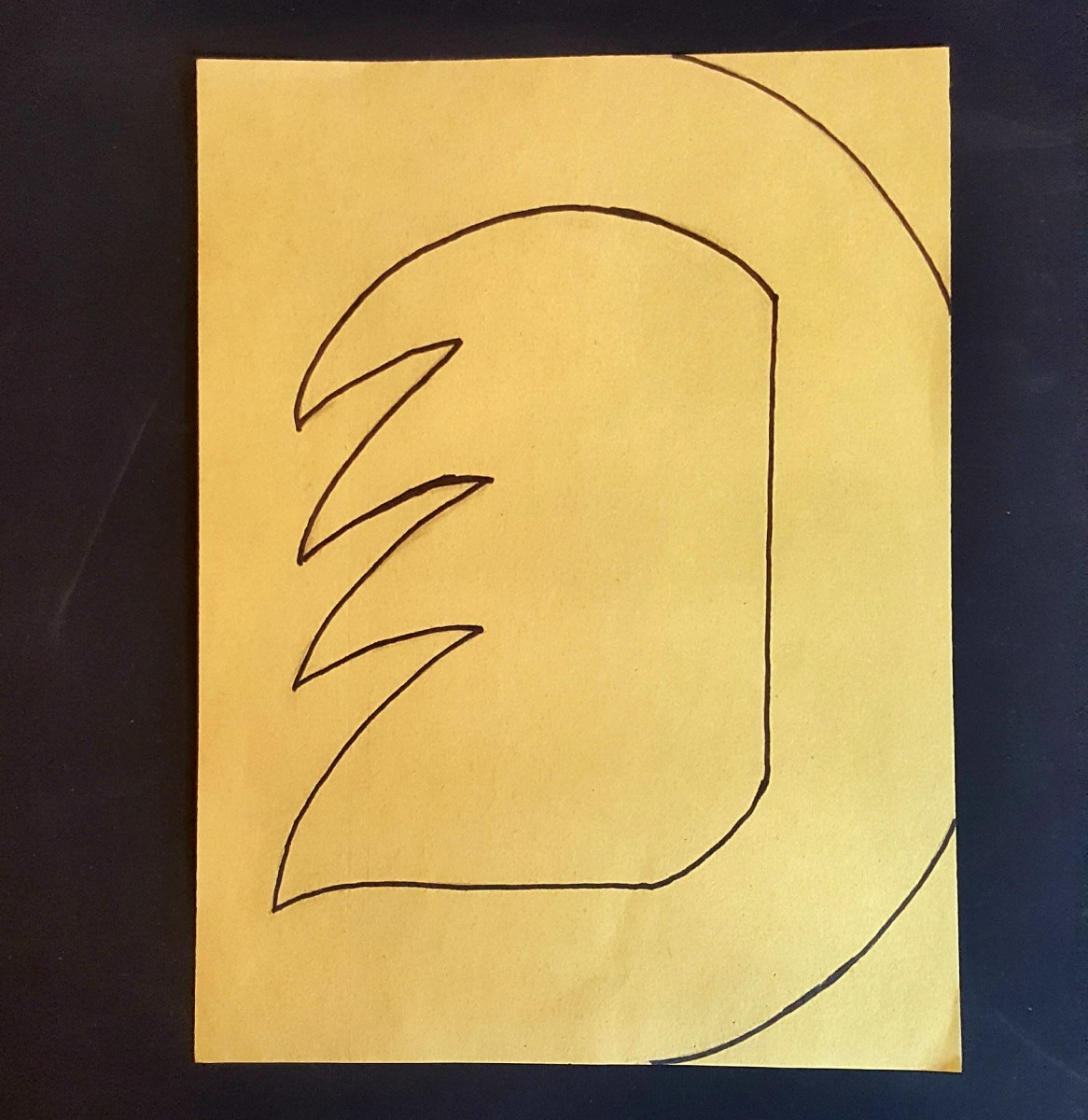"Trace the letter ""D"" with black marker."