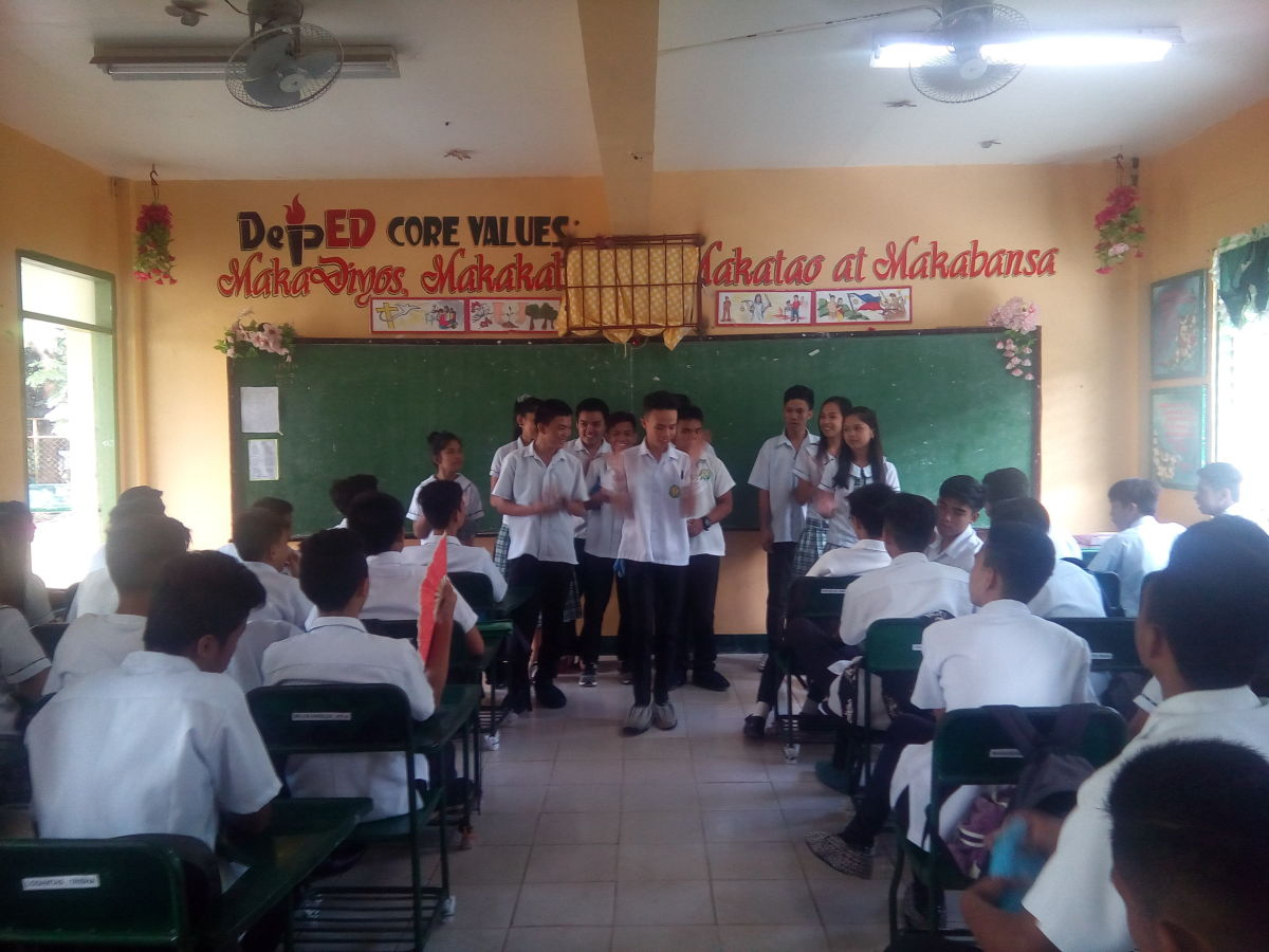 grade 10 students during a group presentation in class