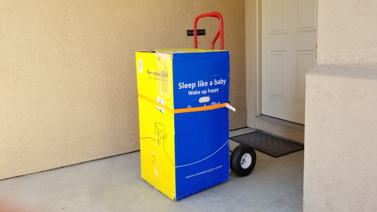 The King size mattress is 107 lbs so we had to use a hand truck to bring it inside the house.