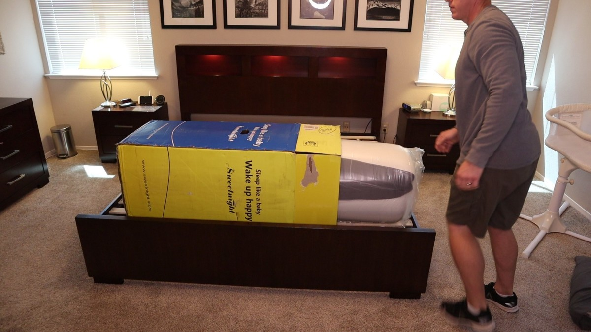 My husband pulls the rolled and compressed Sweetnight mattress from it's box.