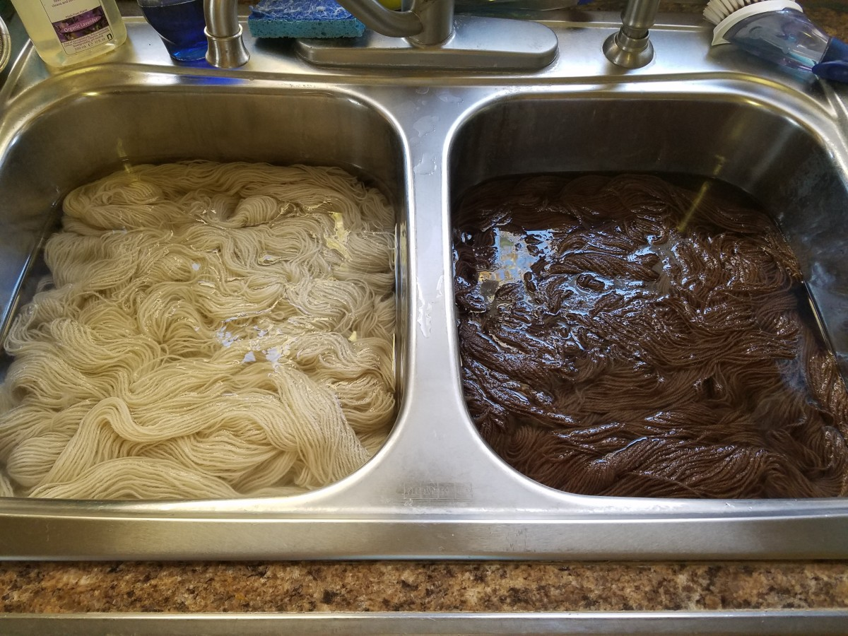 Hand washing alpaca yarn.