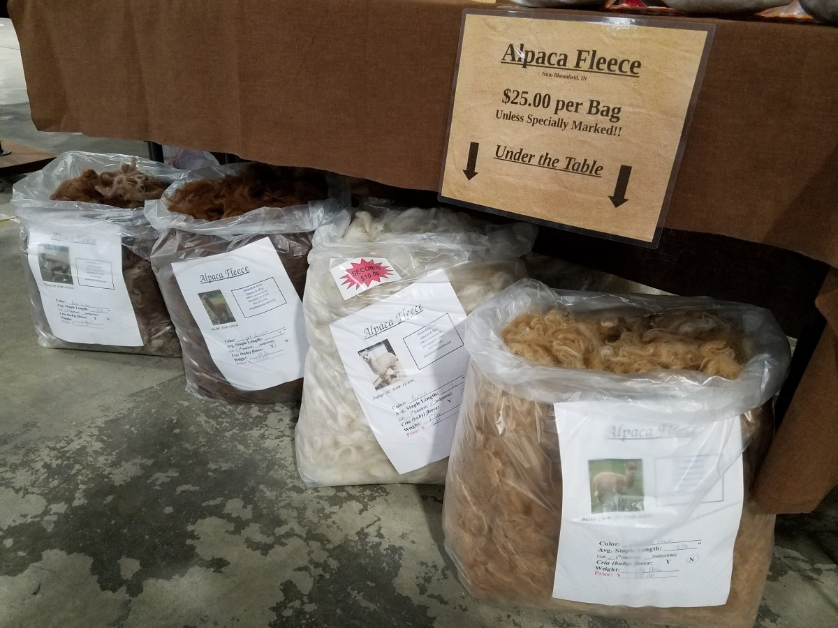 Bags of raw fleece fit nicely under the table at market.