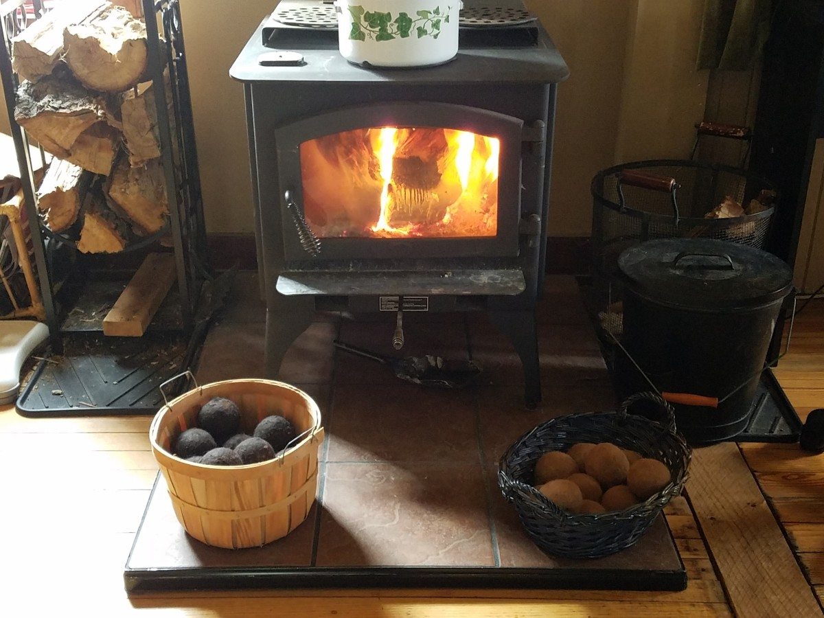 Dryer balls drying by the fire.