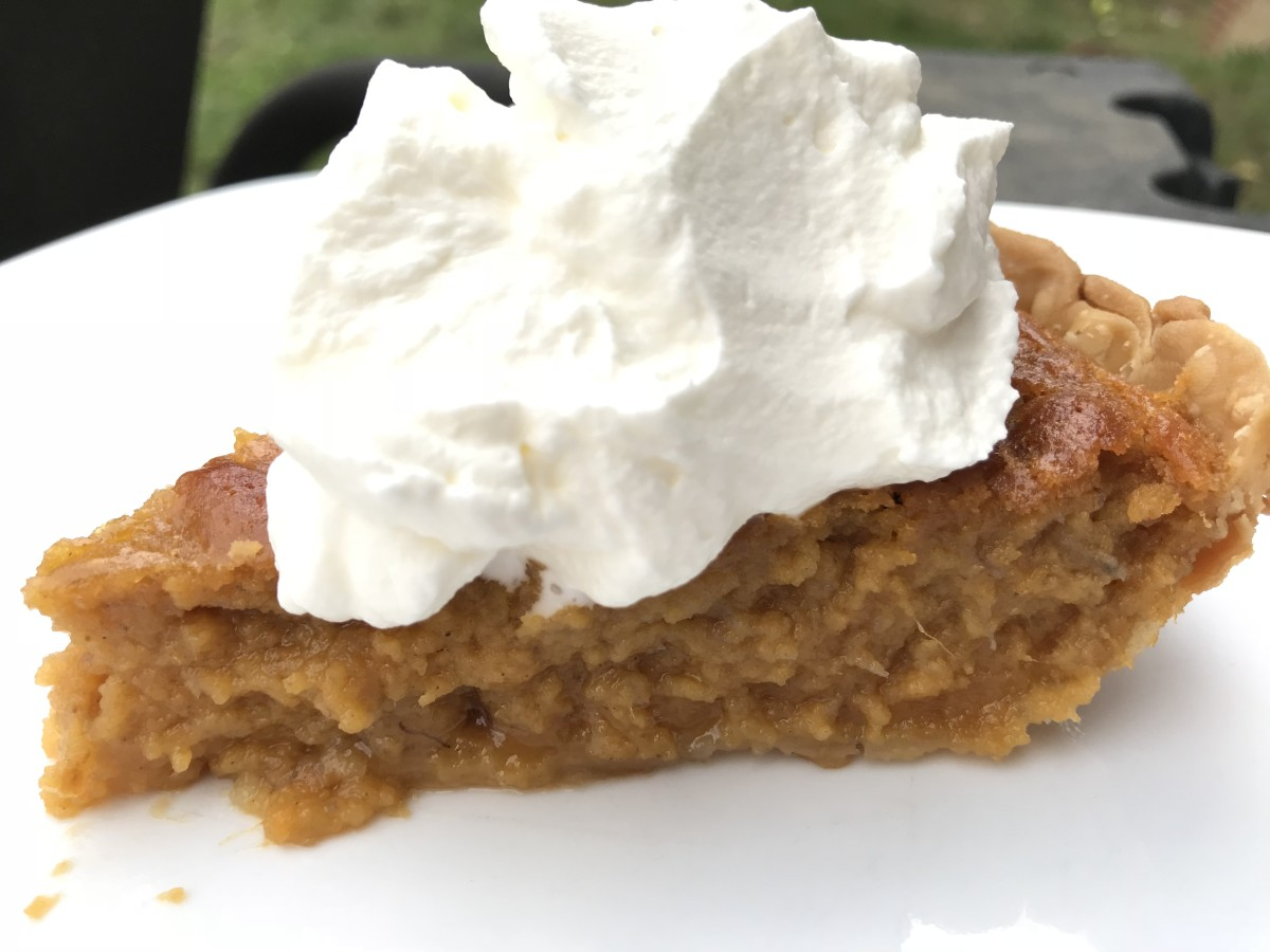 Southern sweet potato pie is a classic holiday dessert - a silky custard pie that is perfectly paired with freshly whipped cream.