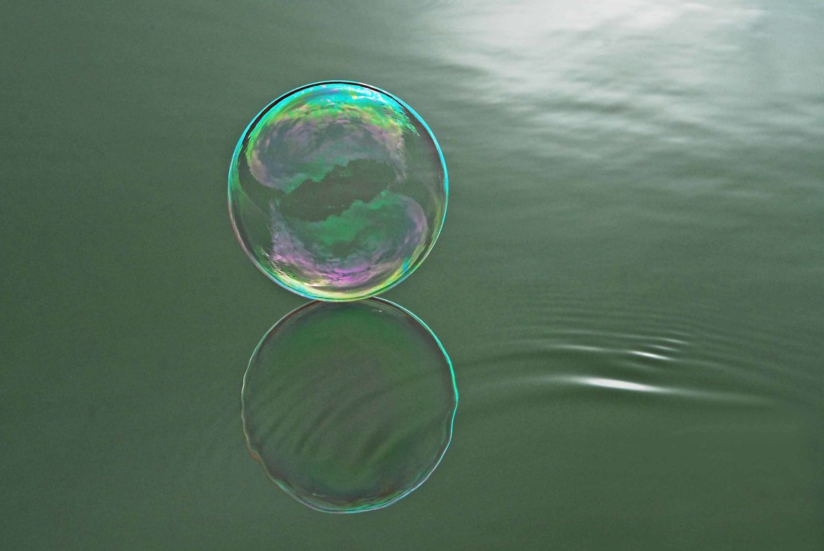 A beautiful bubble dancing on water.