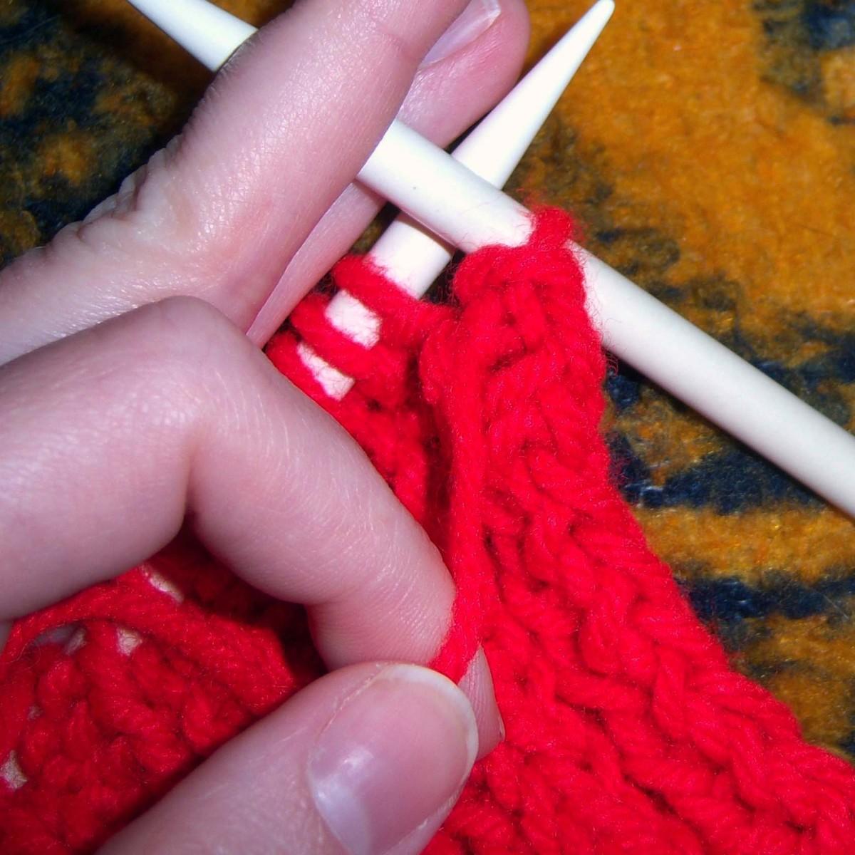 Purl the next stitch.