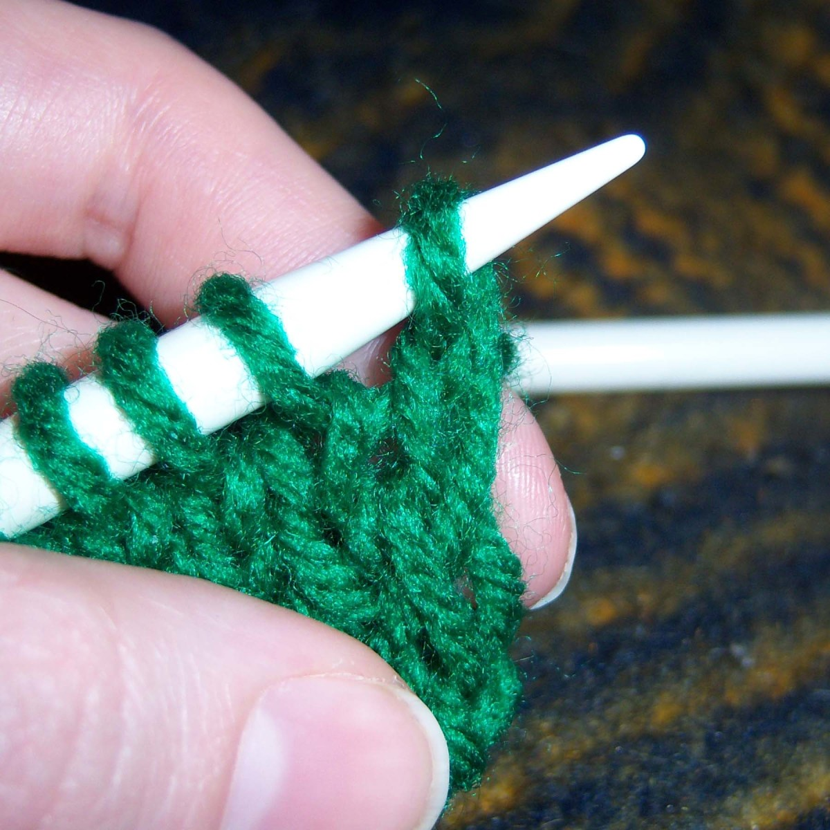 Transfer that stitch onto the other needle.