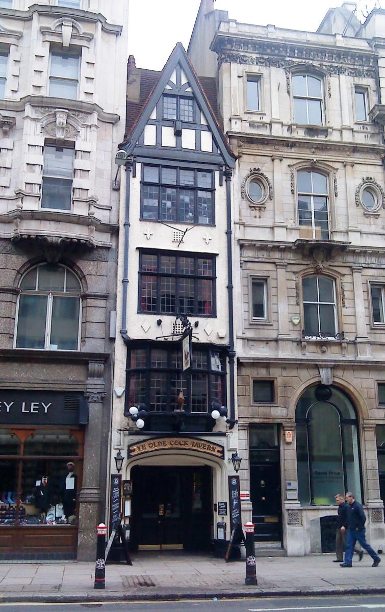 In London's Fleet Street, sandwiched between two larger buildings.