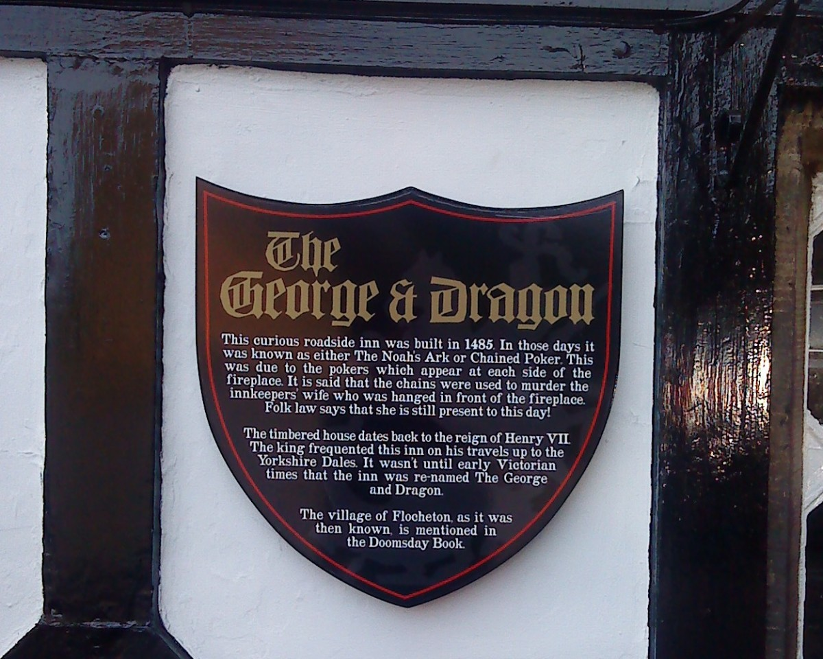 The plaque on the outside wall of the George and Dragon telling the story of Murder most foul!