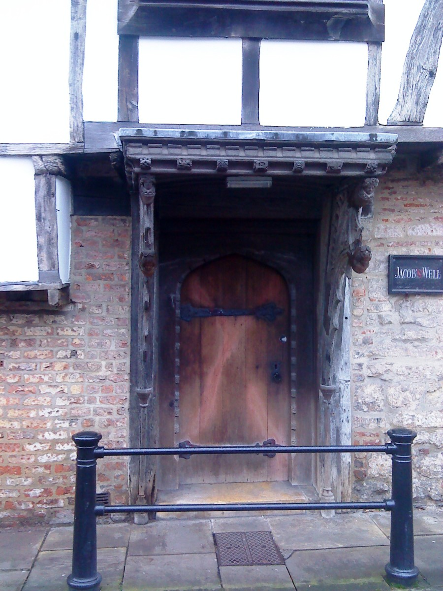 Wooden doorway to Jacob's Well in York.