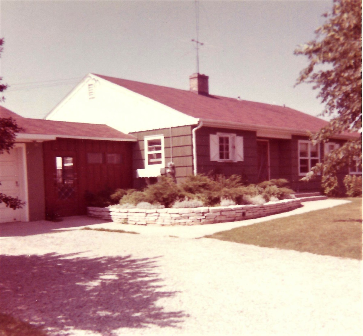 My childhood home in Wisconsin showing TV antenna on roof