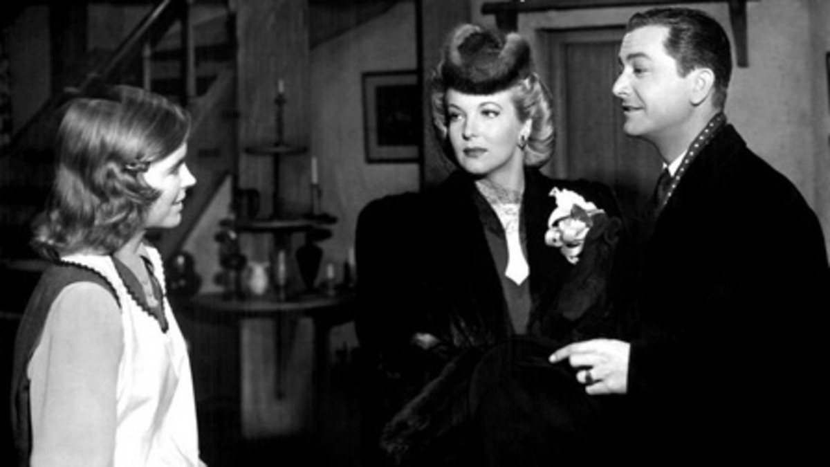 Oliver and Beatrice talk to Laura.  Hillary Brooke, Robert Young and Dorothy McGuire