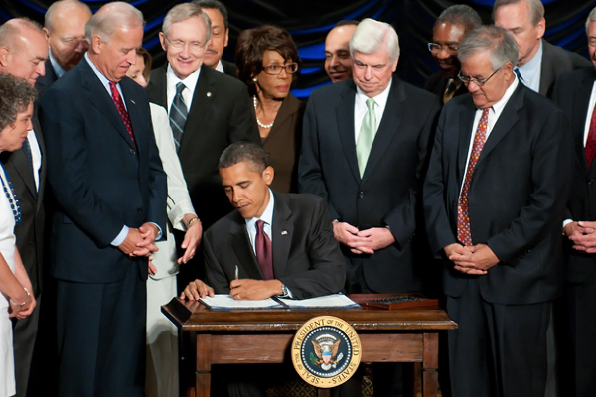 Obama signing into law the Dodd Frank Amendment