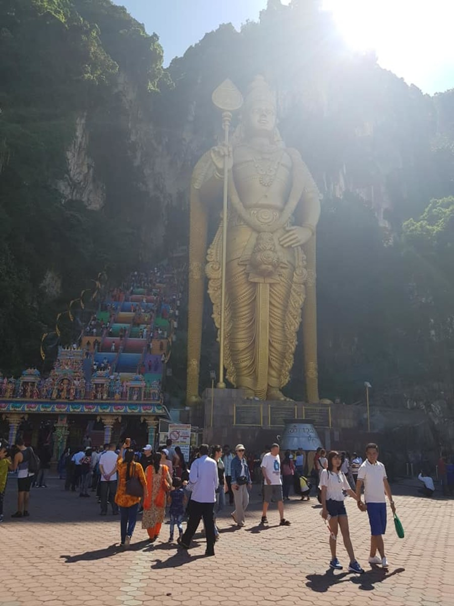 For better photos without so many tourists, get to the Batu Caves earlier (don't miss your train like we did).
