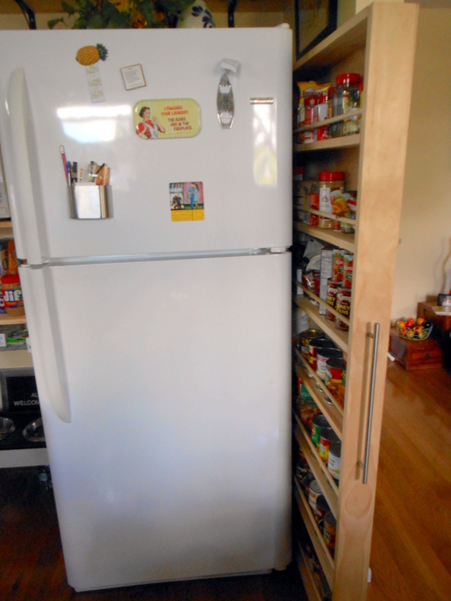 That narrow space between the refrigerator and the wall IS now our pull-out kitchen pantry. It's fabulous and EASY to DIY.