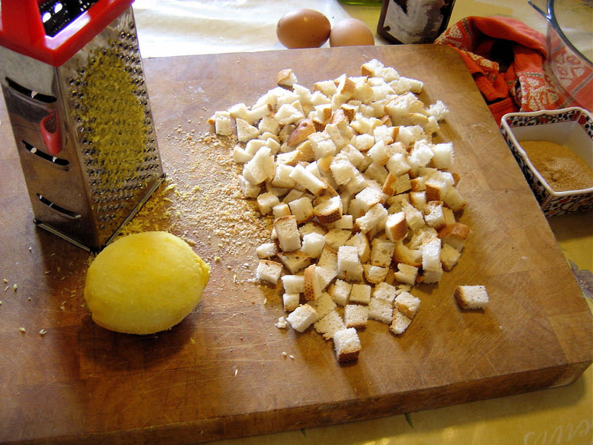 Dice the bread and grate the lemon zest.