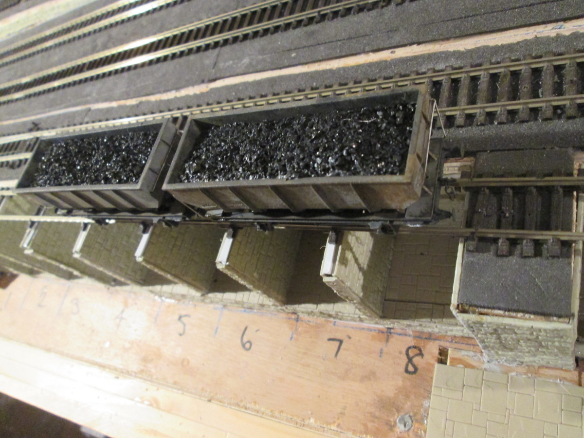 Overhead view of the coal cells with a pair of ex-LNER 21 ton steel hoppers (Diagram 100). Sleepers removed over cells, with sleepers kept on cell walls to retain track gauge. ..
