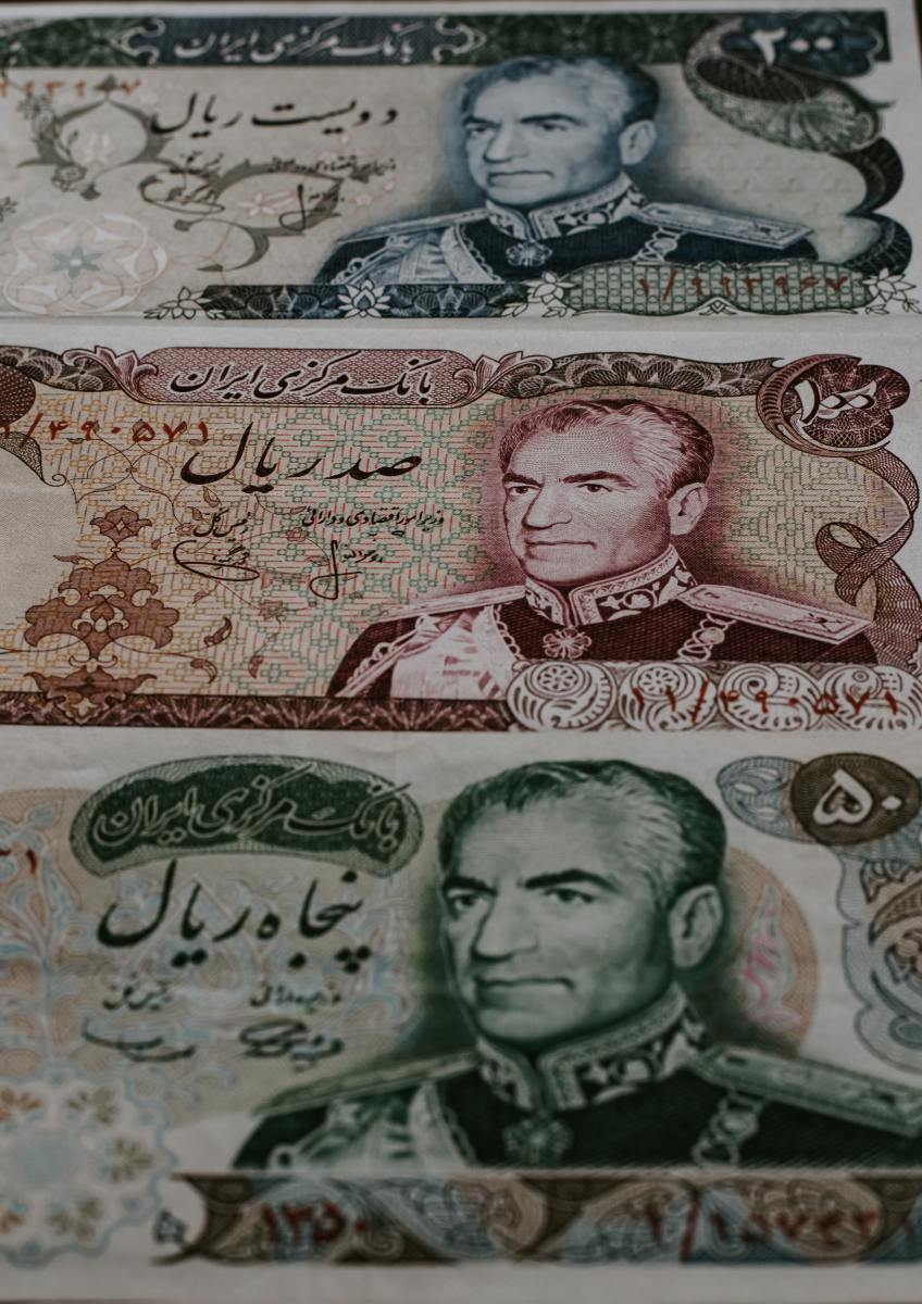 Bank notes and money showing the image of the last shah of Iran.