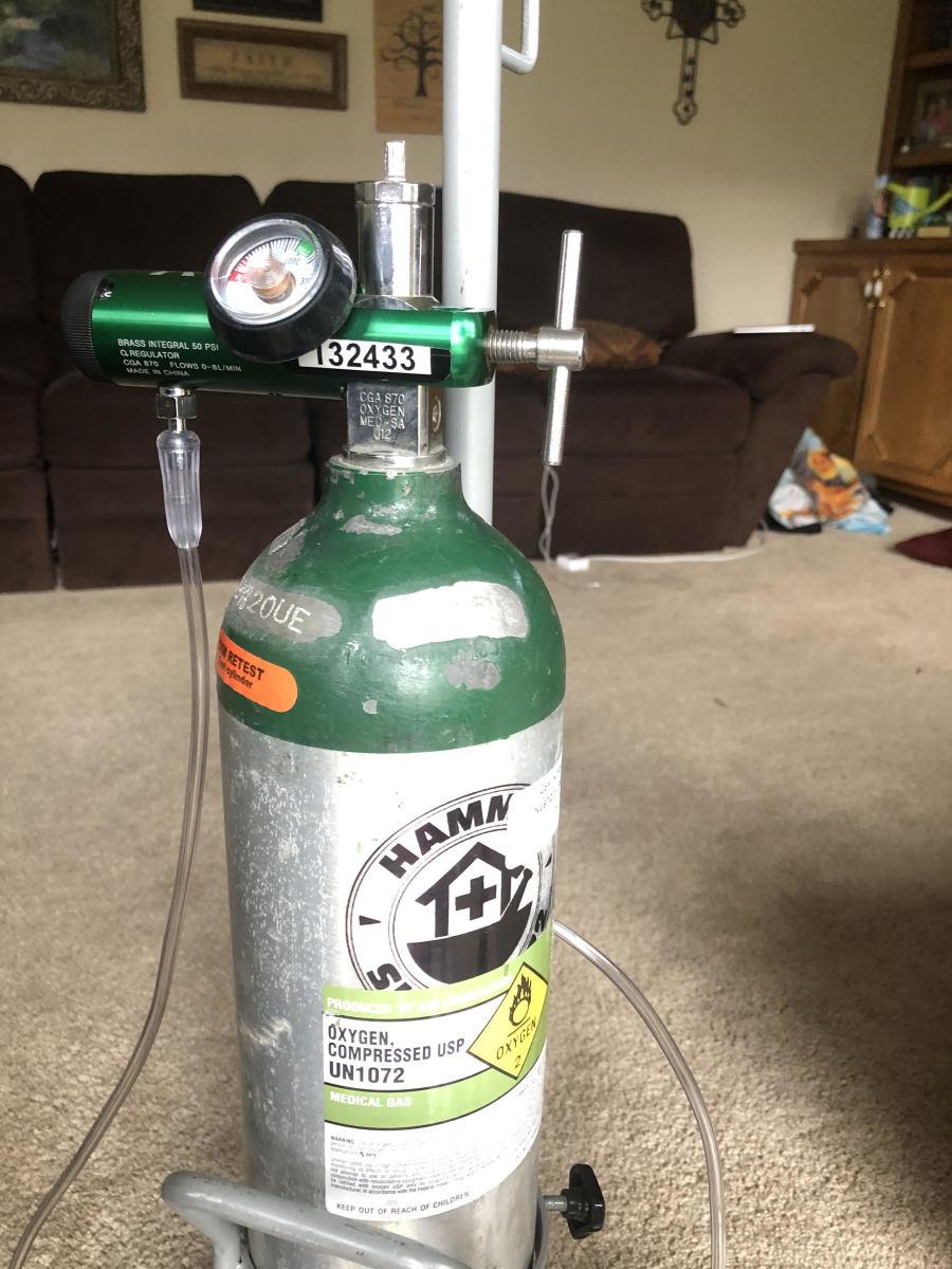 Portable oxygen tank.