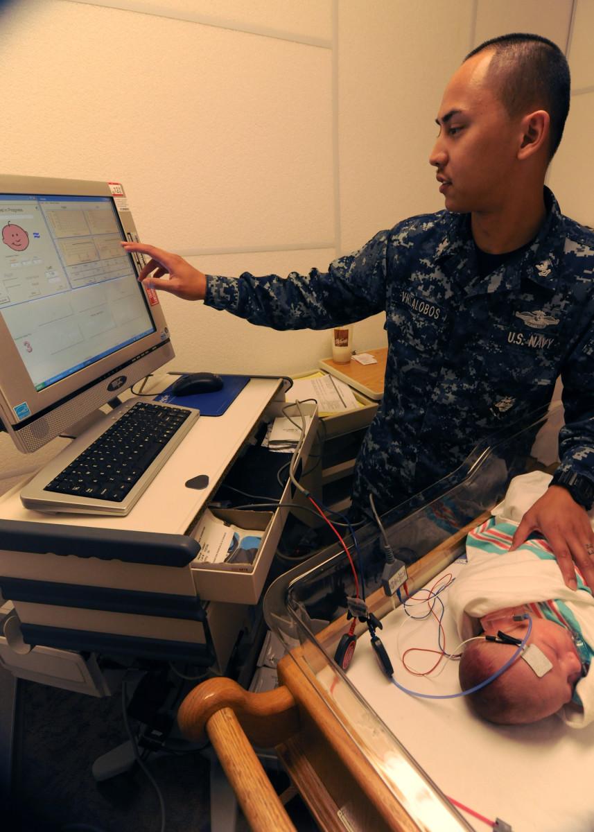 A baby receives a newborn hearing screening test.