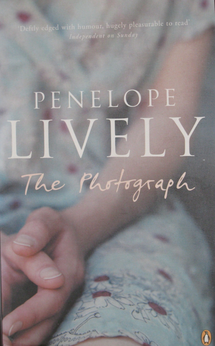 Penelope Lively's 'THE PHOTOGRAPH': A Review.  Effect of a forgotten photo disrupting people's lives.