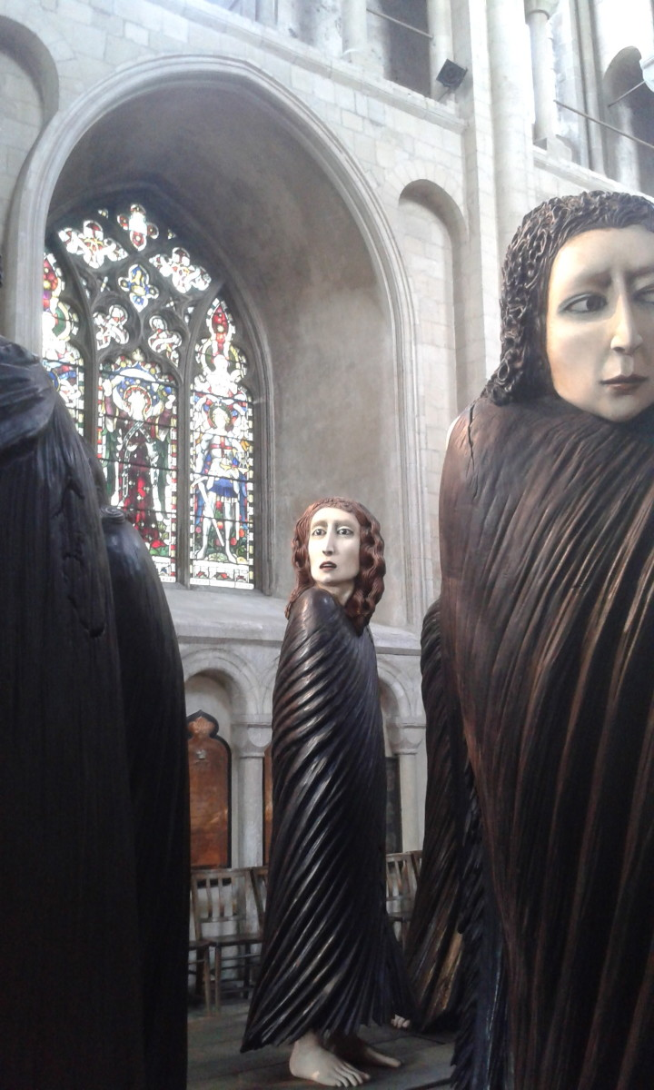 An art installation in Norwich Cathedral.  They look like wandering mourners or lost souls.