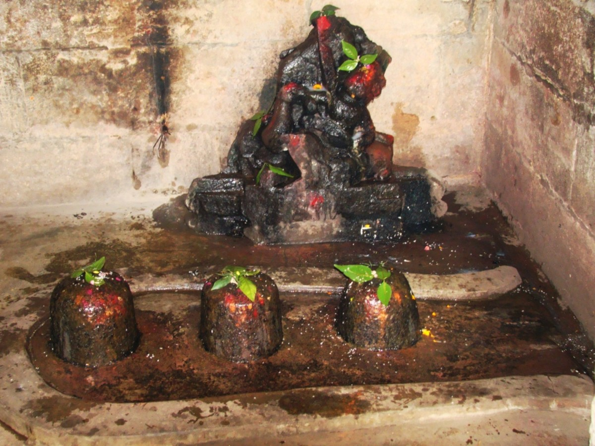 Inside temple no. 1(three Shiva Lingams in front)