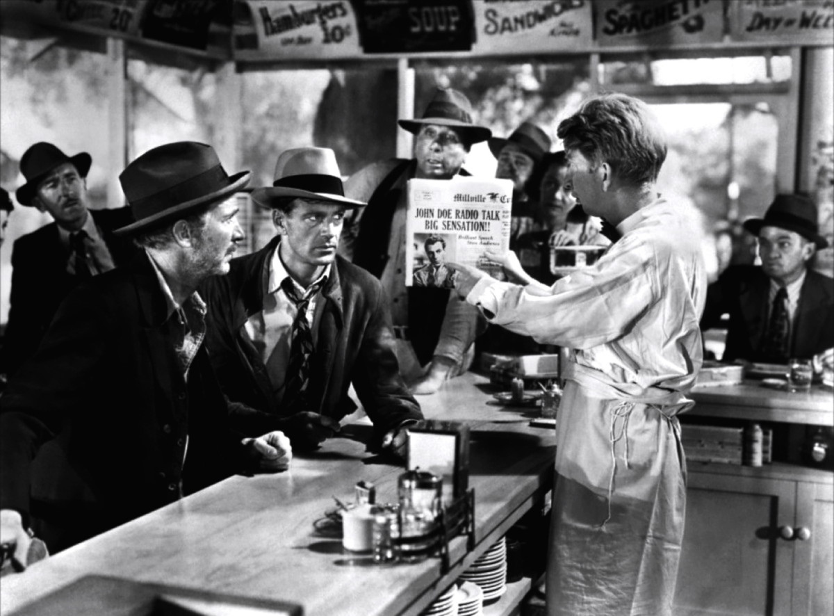 Gary Cooper and Walter Brennan are caught by Sterling Holloway in a diner.