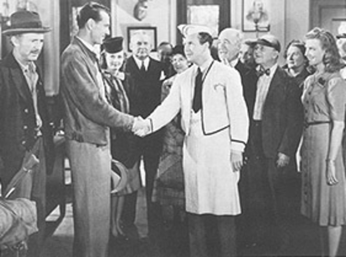 Regis Toomey, chapter president of the John Doe club meets Gary Cooper.