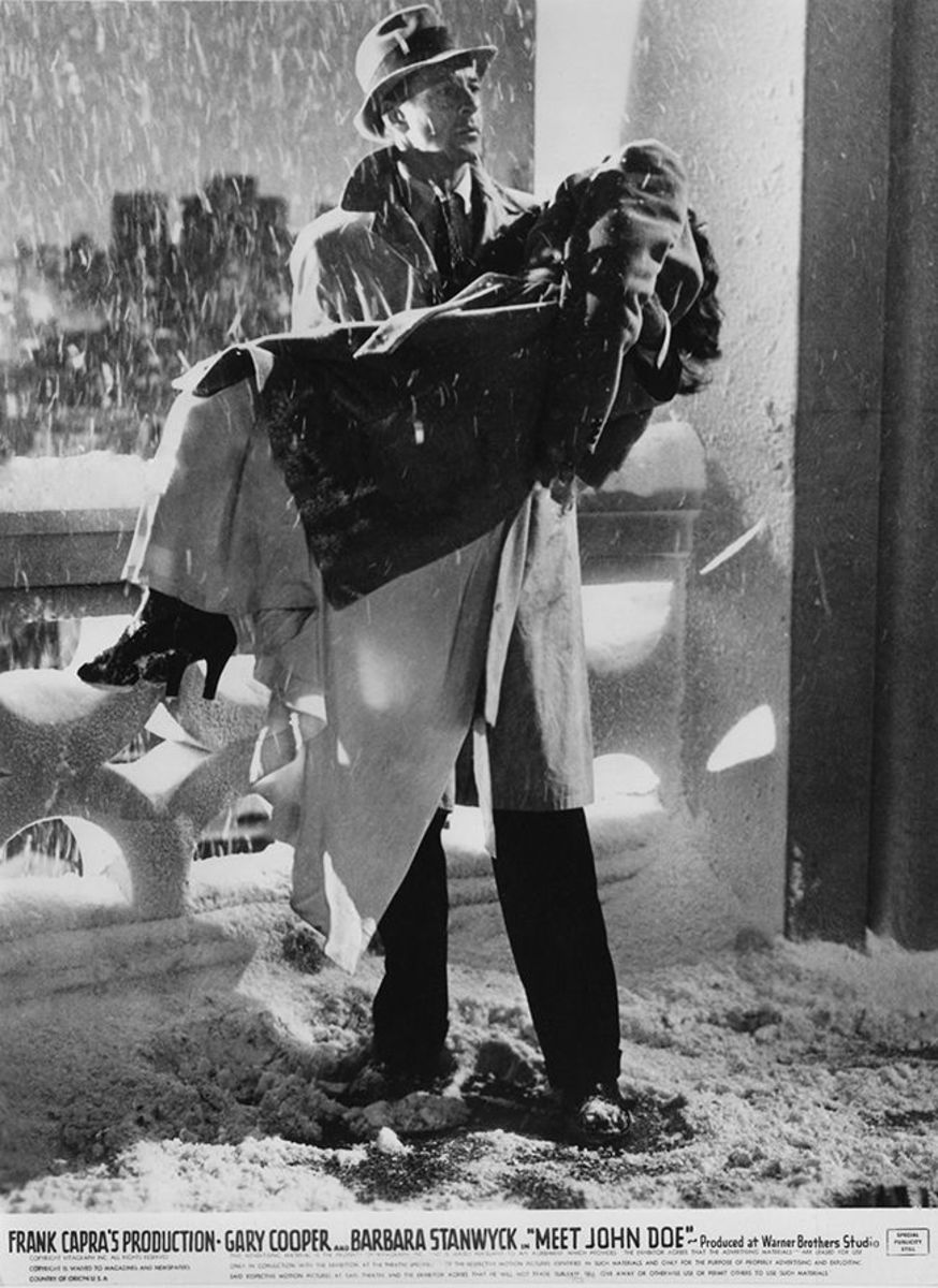 Gary Cooper carries the fainted Barbara Stanwyck