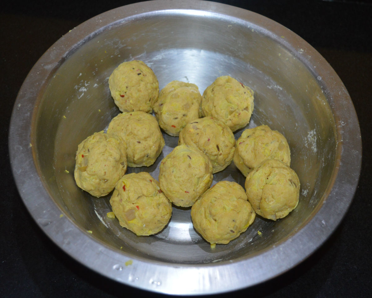 Divide the dough into many equal lemon-sized portions. Shape each portion like a patty.