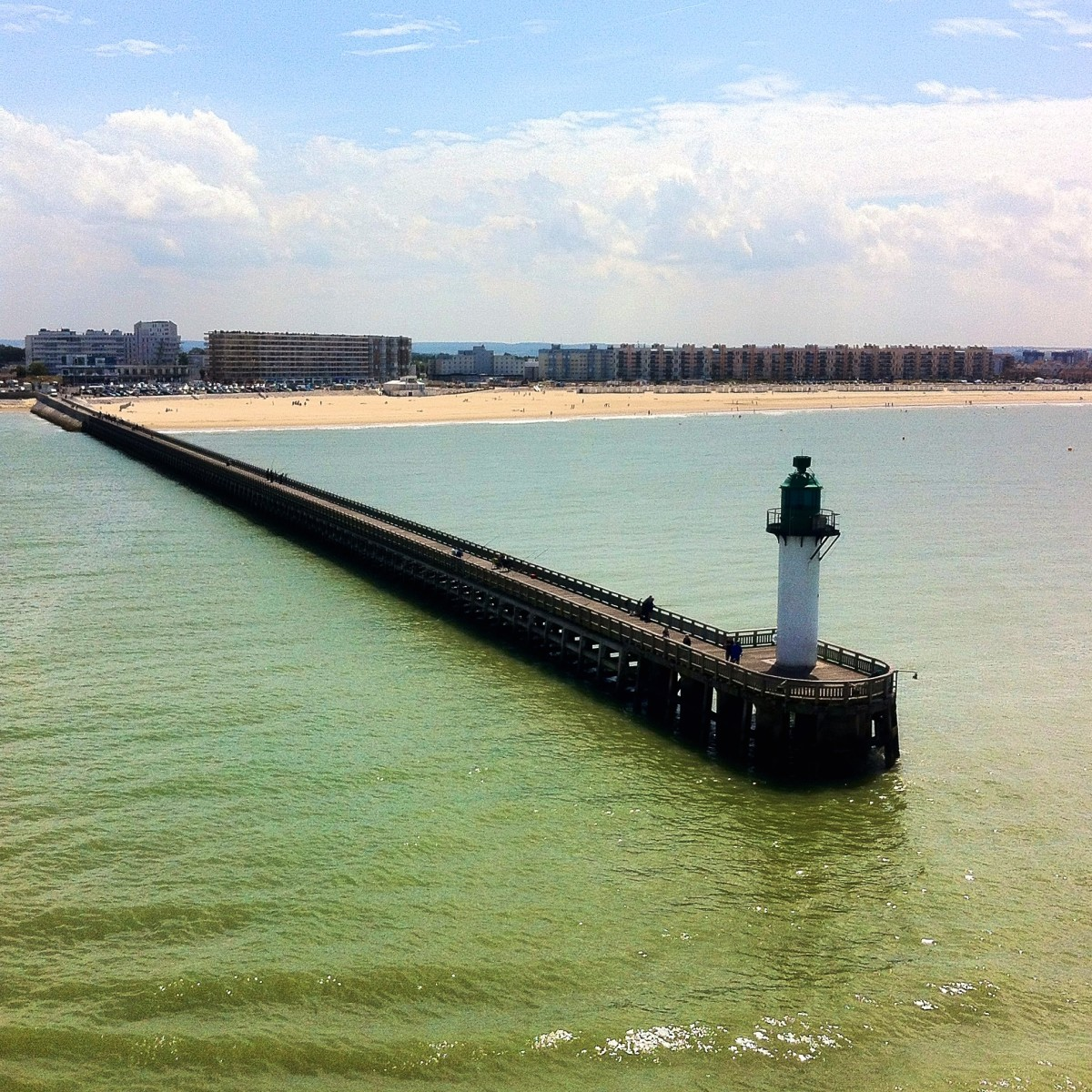 The pier and lighthouse of the port of Calais