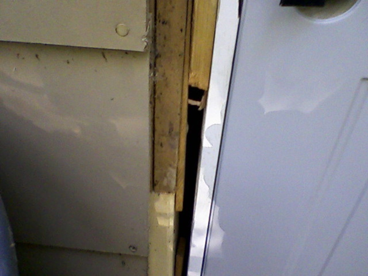 Door shimmed in place.  Note how wide the gap here is.