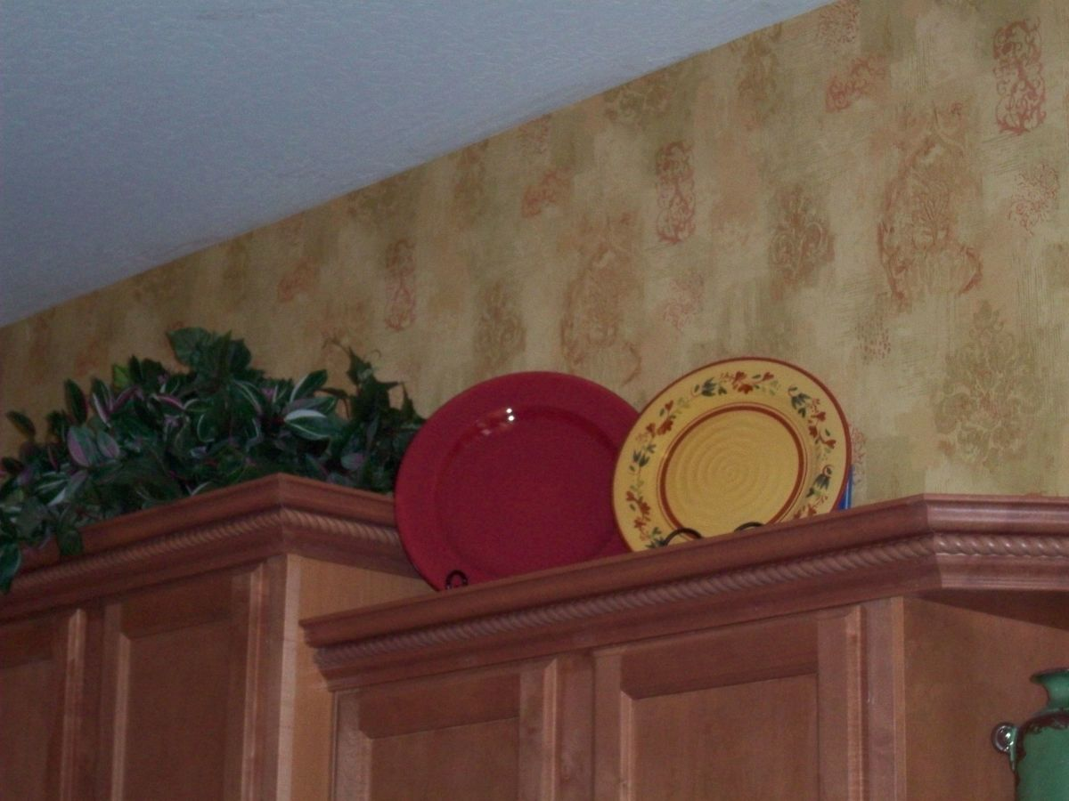 Display your favorite serving pieces above kitchen cabinets