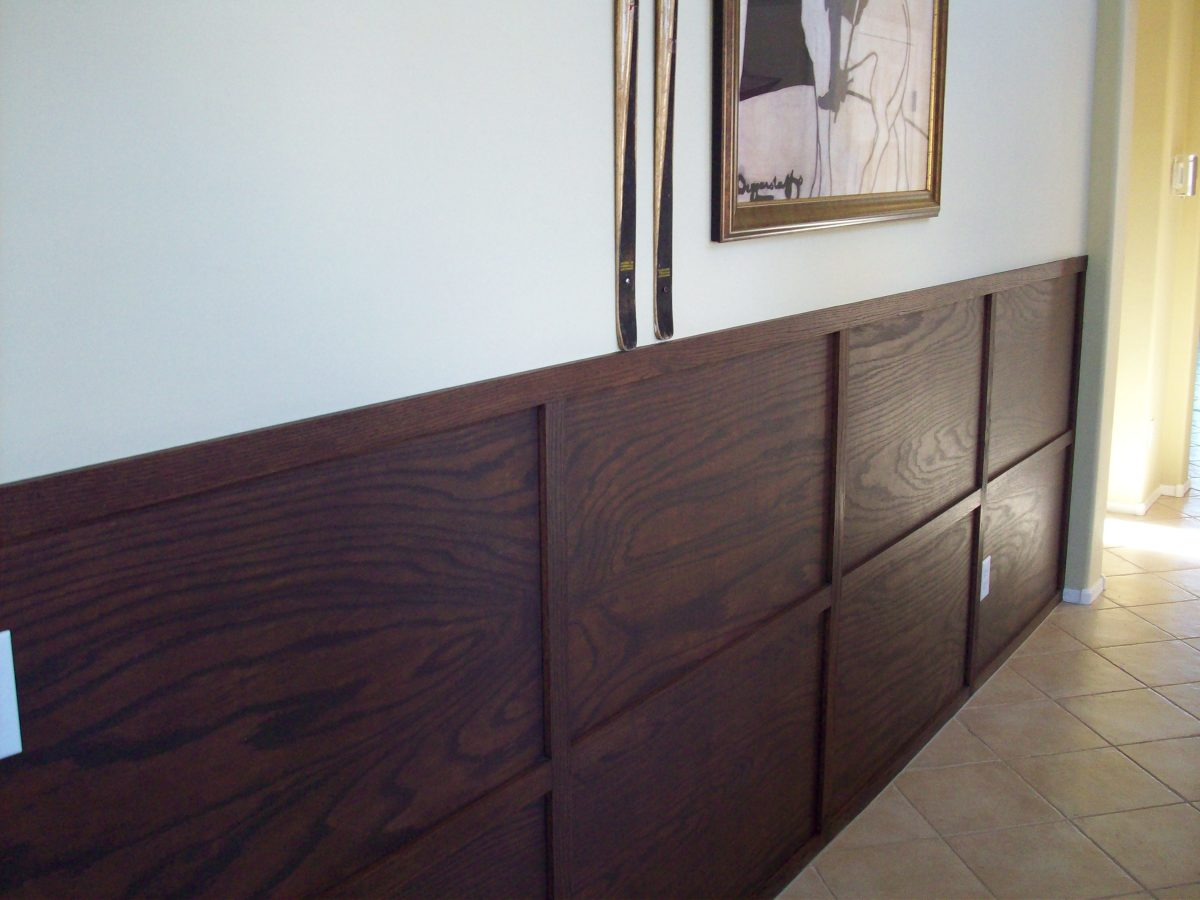 Instead of traditional wainscoting, wood paneling can be used to create an attractive and more masculine look.