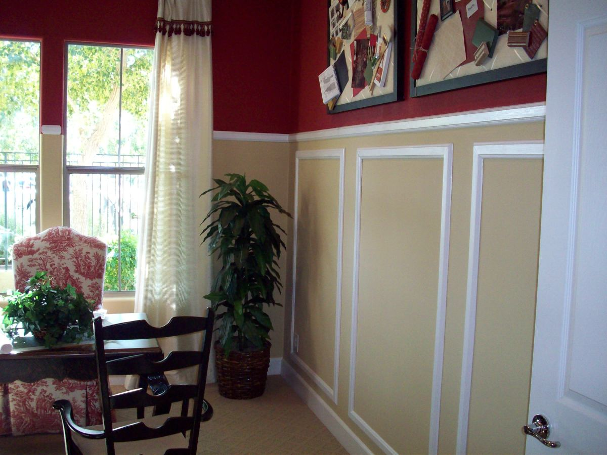 In this room, the chair rail is higher than the traditional 3 feet.  There is also decorative trim work below the chair rail that adds depth to the room's decor.