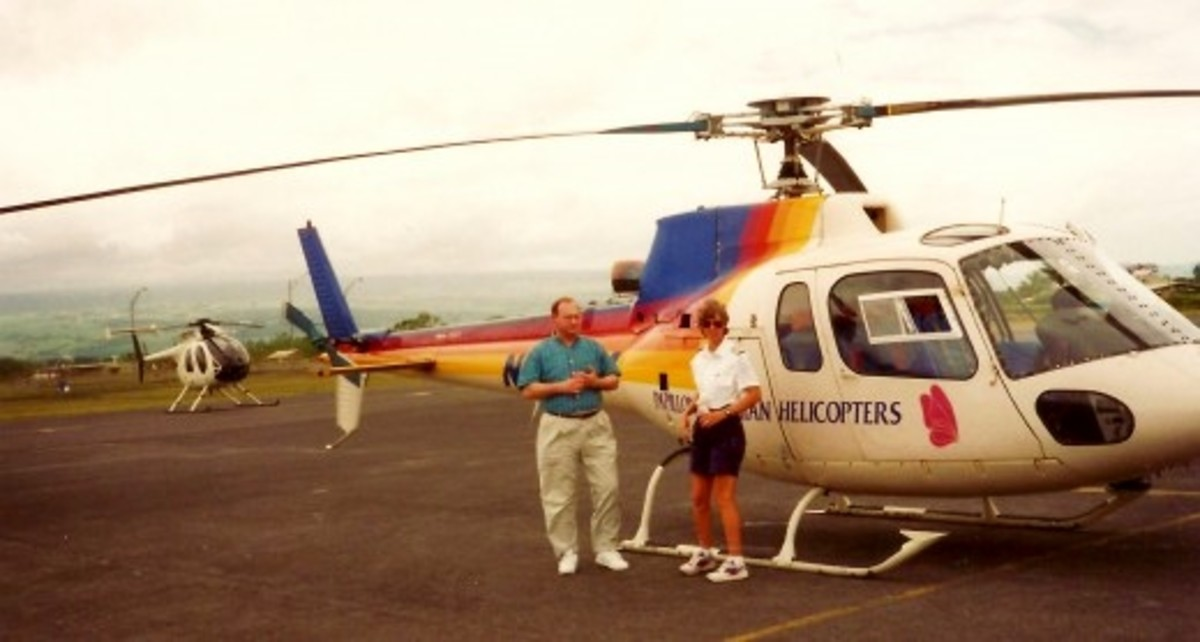 Stopping in Hilo to refuel the helicopter.  My husband is talking to the pilot in this photo.