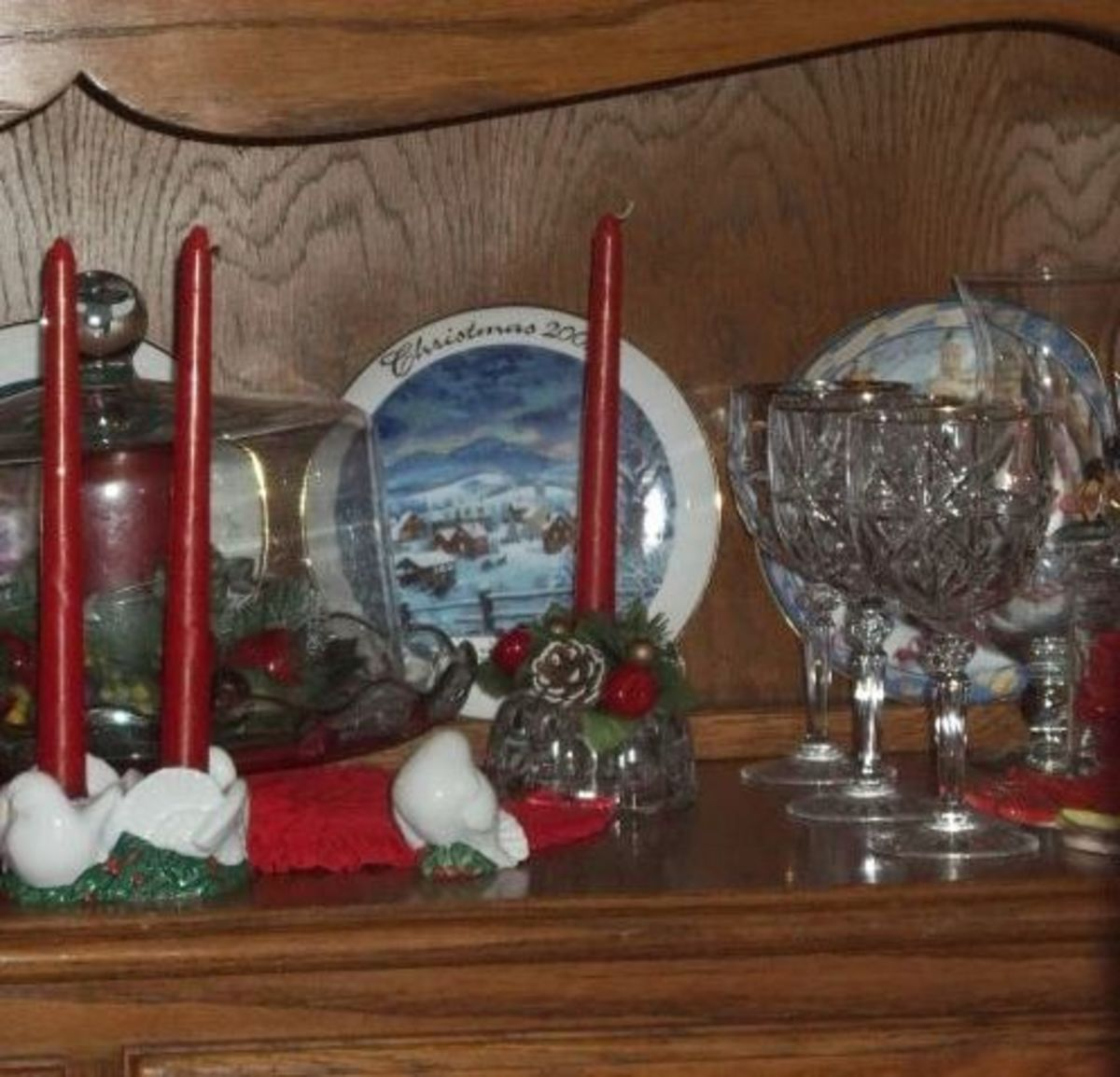 Use what you have. Decorate inside a cake dish and set out your best goblets for decorations.  My sister used lots of clear glass, antique family candle holders and gold throughout the house for this Christmas at home theme.
