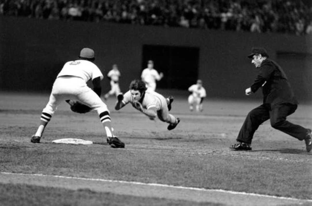 Pete Rose beats the relay, 9th inning of Game 7 1975.