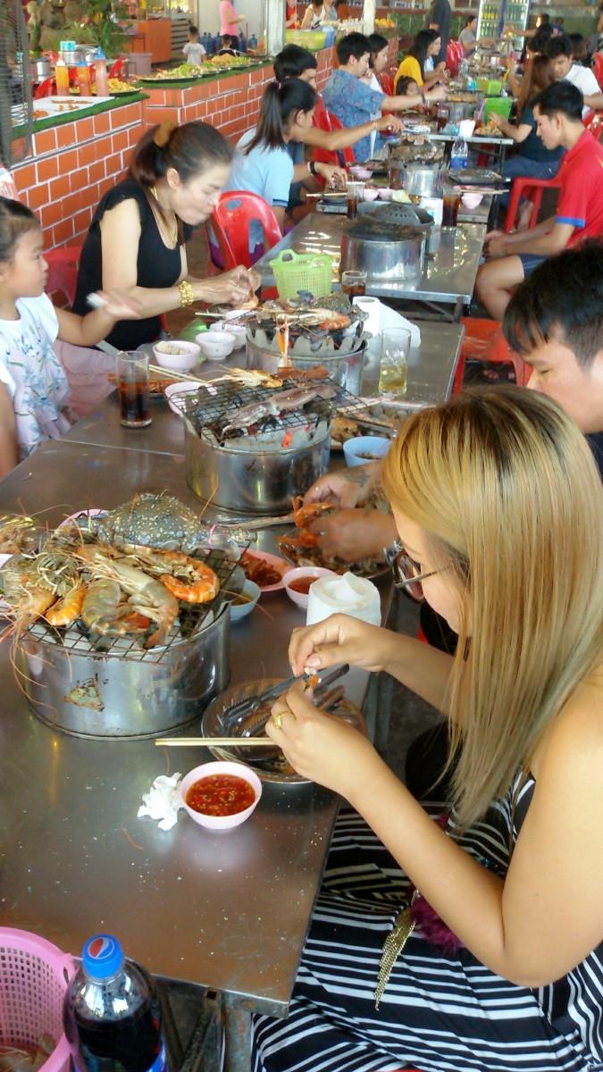 Enjoying a Thai-style seafood buffet.