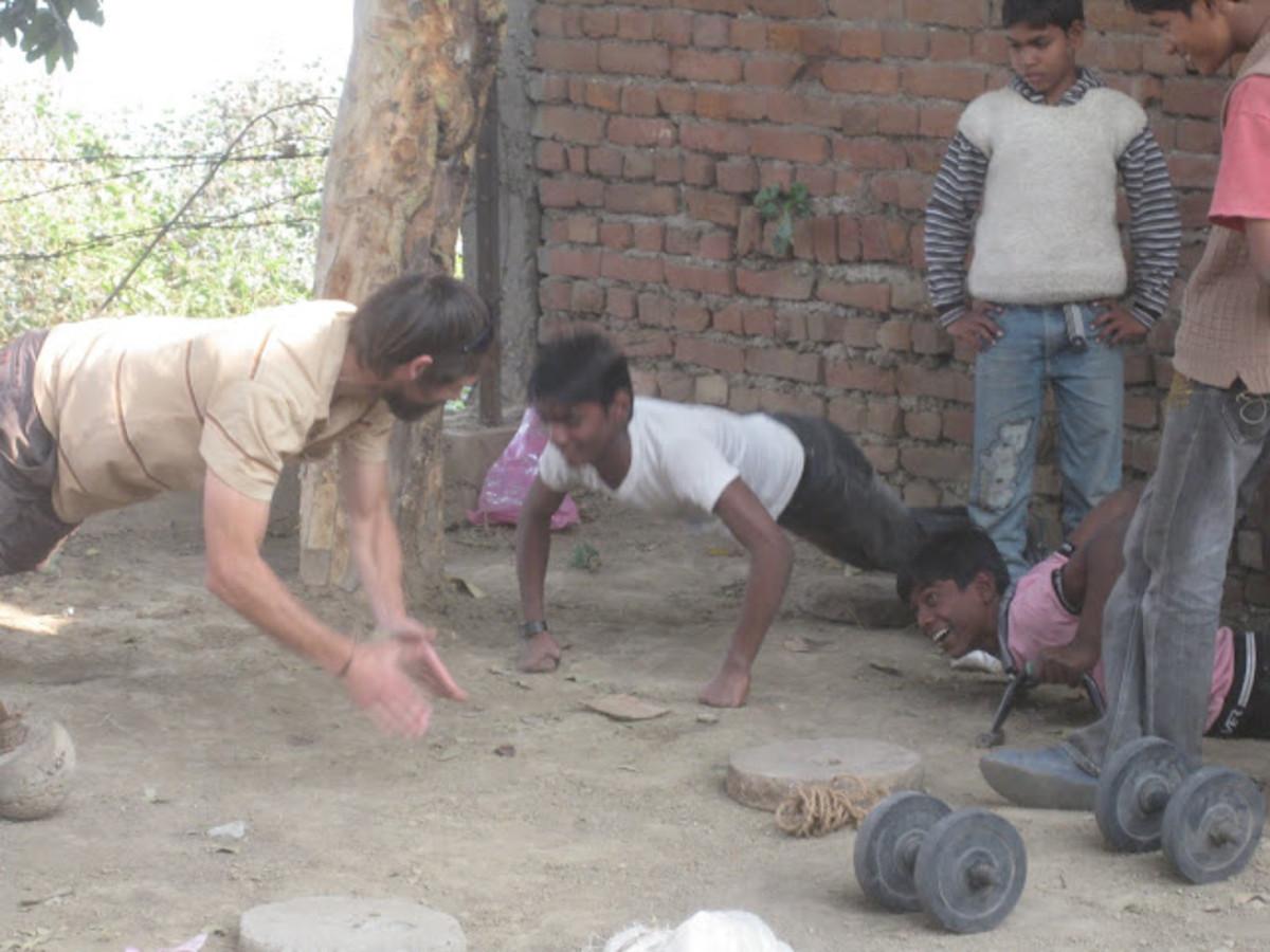 Villagers doing clap pushups