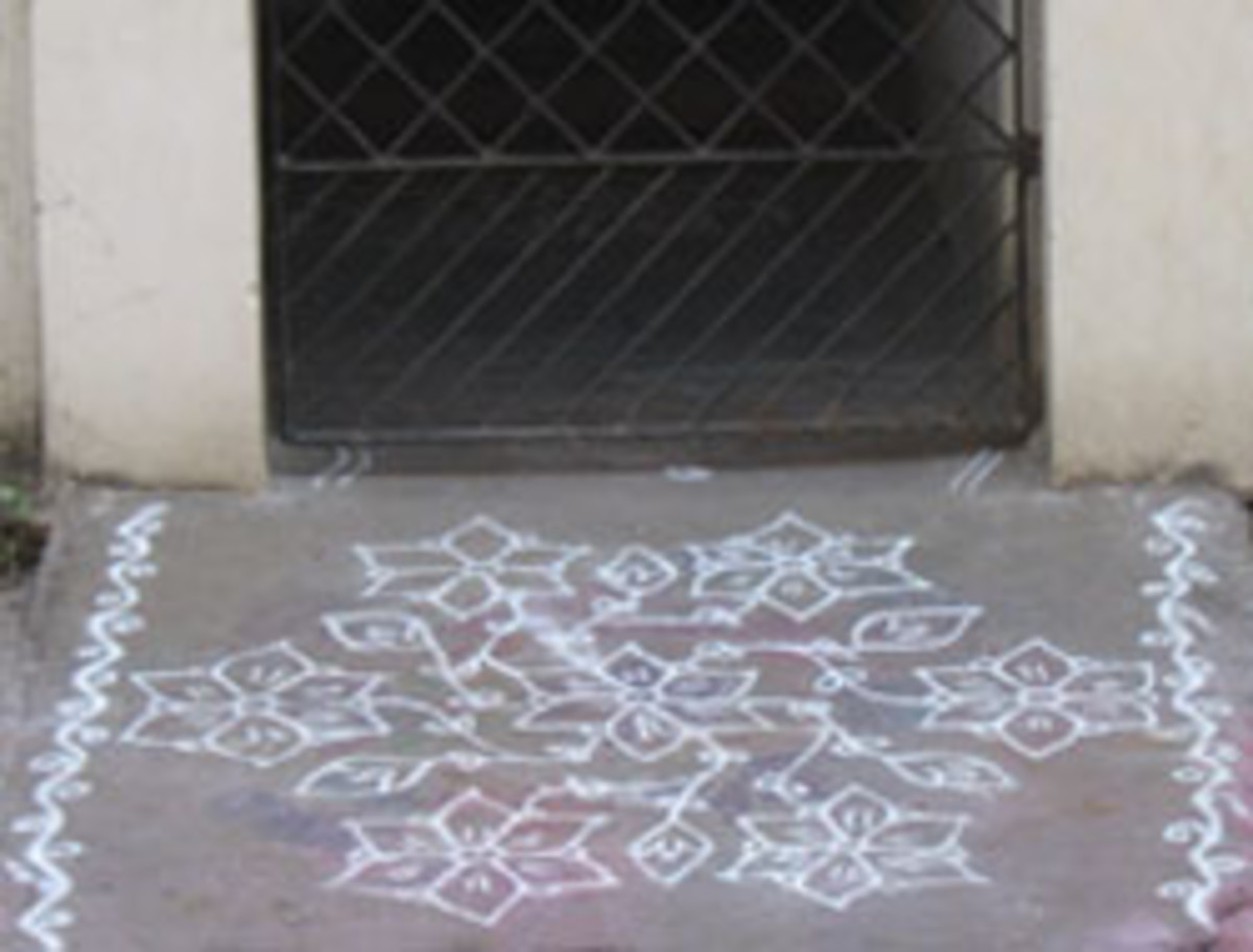 1. A Kolam in front of the entrance of a house.