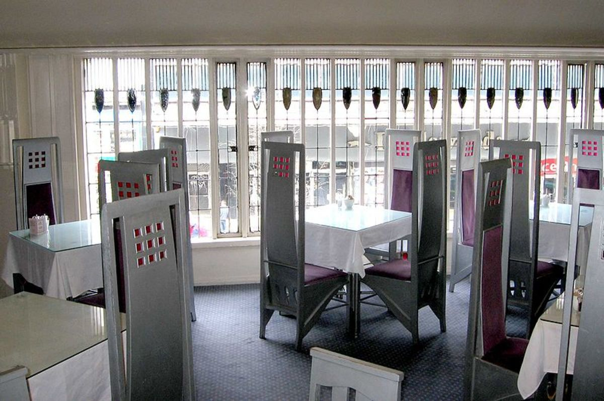The clean lines and perfectly proportioned furniture compliments the unique stylised windows of the Willow Tea Rooms, Glasgow