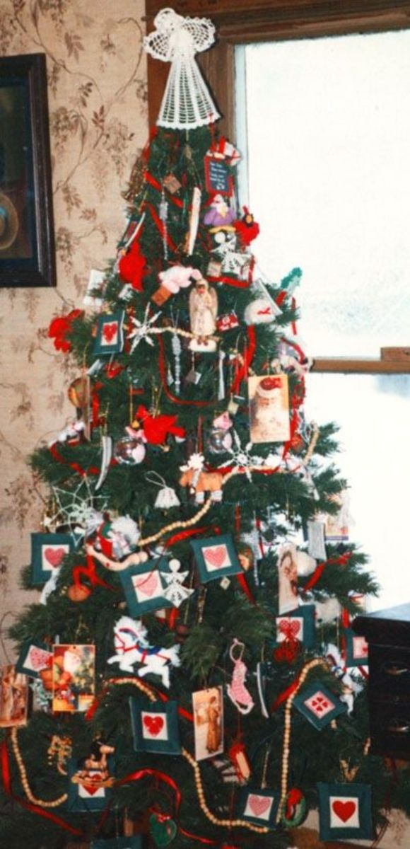 Our Christmas Tree With Wooden Block Ornaments On It.
