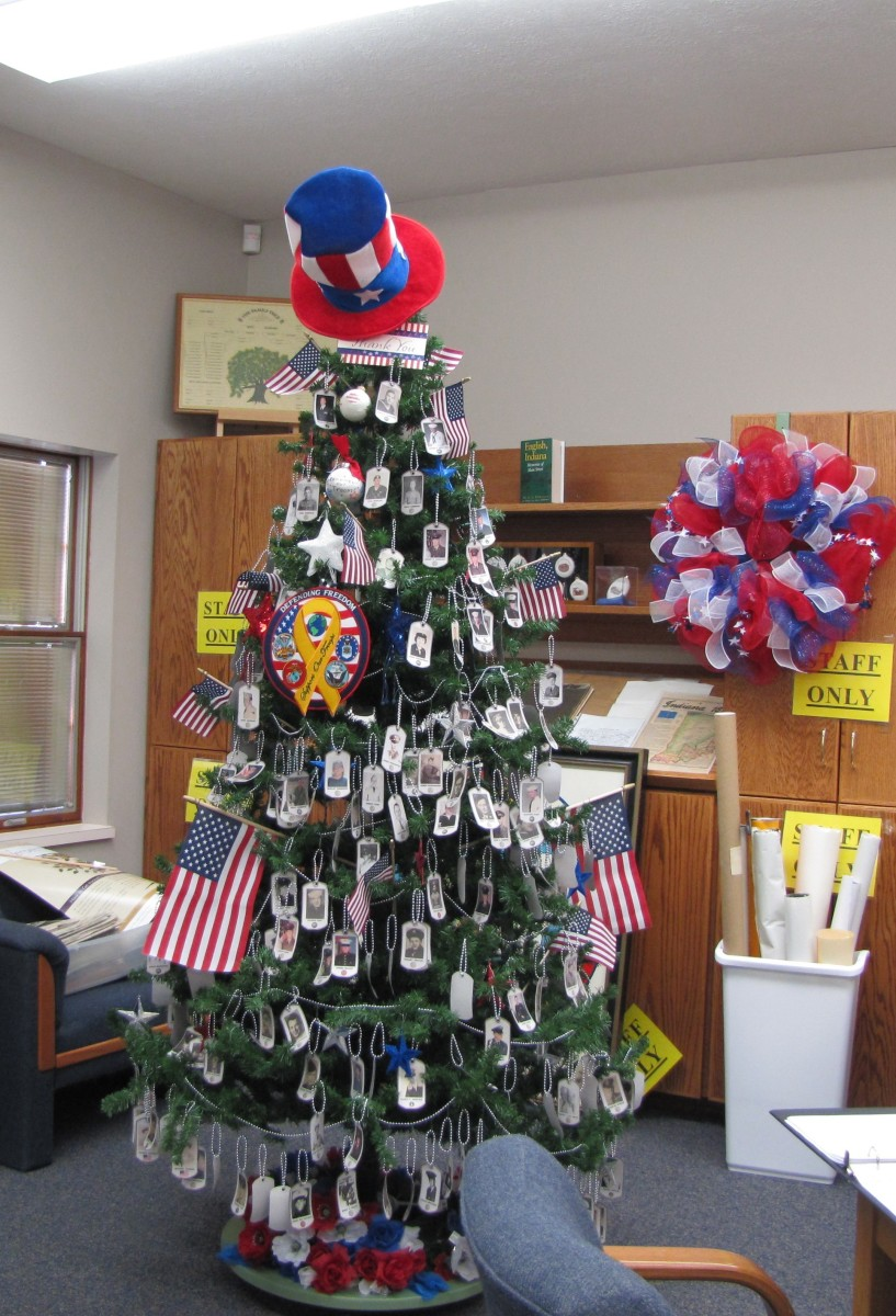 How clever, they put Uncle Sam's hat on the top of the tree. Lots of flags and photos of local veterans in uniform fill the tree. I saw this one at a library in Southern Indiana.