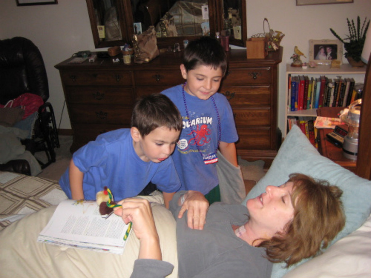 Home from surgery. My kids inspecting the incision.